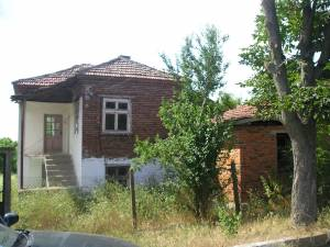 The house requires renovation work, but with a good local builder could become a very attractive house. It is situated on the main asphalt road into the village, and has a large plot of land of 1,765 ...